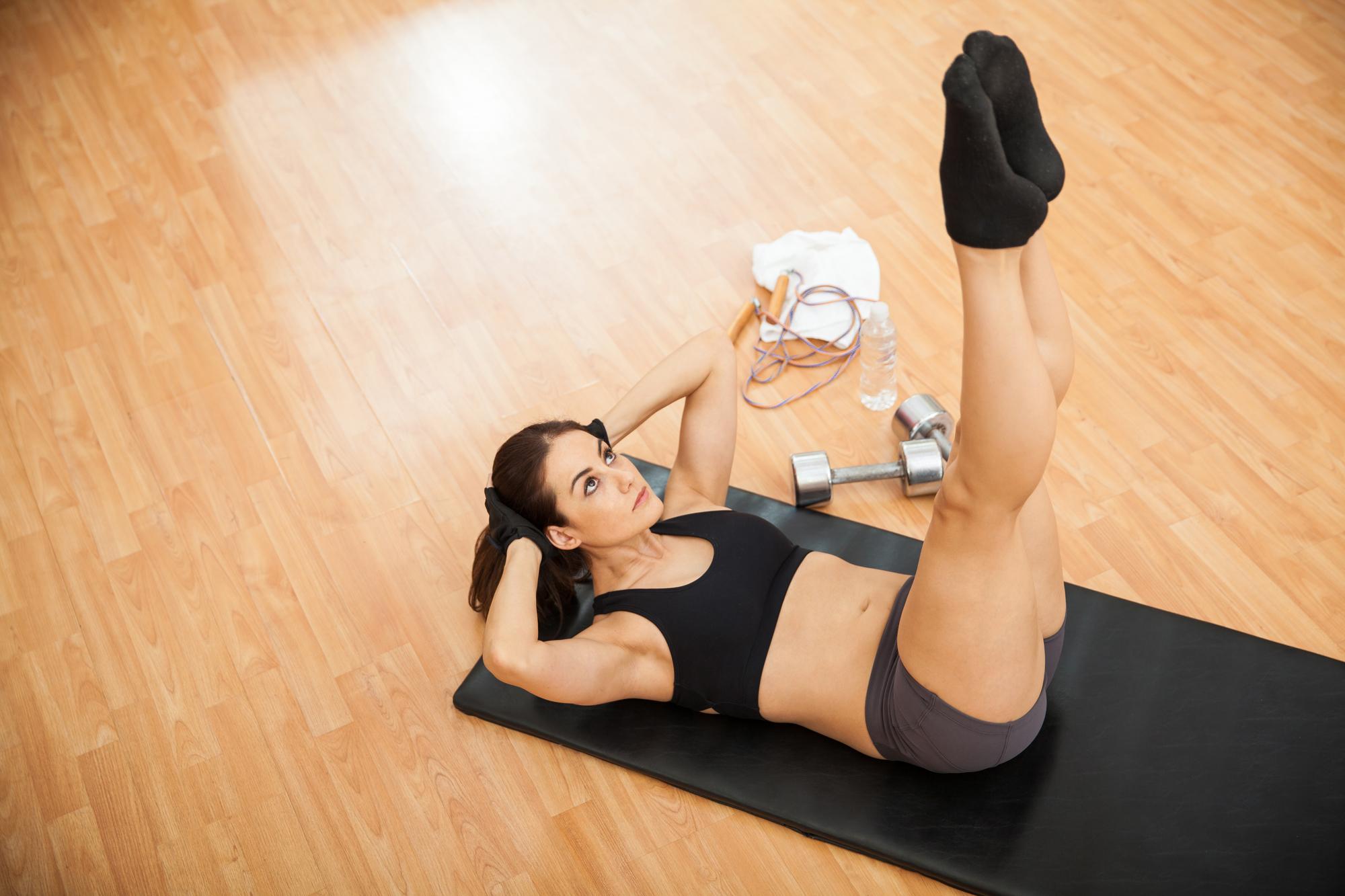 Leg raises at the gym